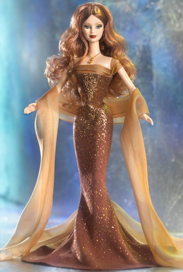 """2002 Birthstone Barbie Collection """"November"""" The dress has glitter the necklace has a real Swarovski crystal."""