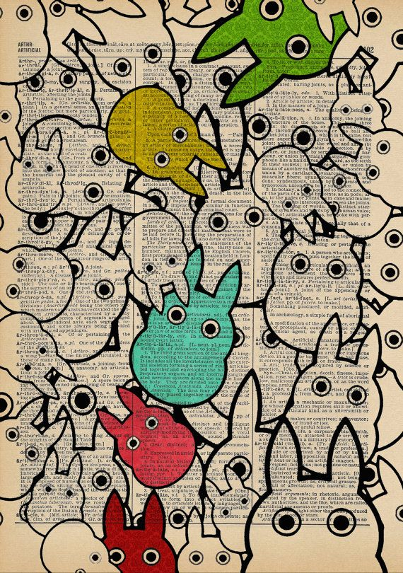 totoros - love the outlines, bits of color, printed on a book page.
