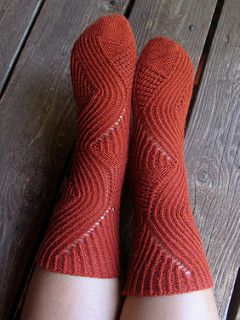 This sock design is an asymmetrical one, where the socks mirror each other. There are lace and twisted ribbing sections that make this sock pattern very stretchy. Magic Mirror now comes in three sizes small, medium, and large with stitch counts of 56, 64, and 72 stitches.