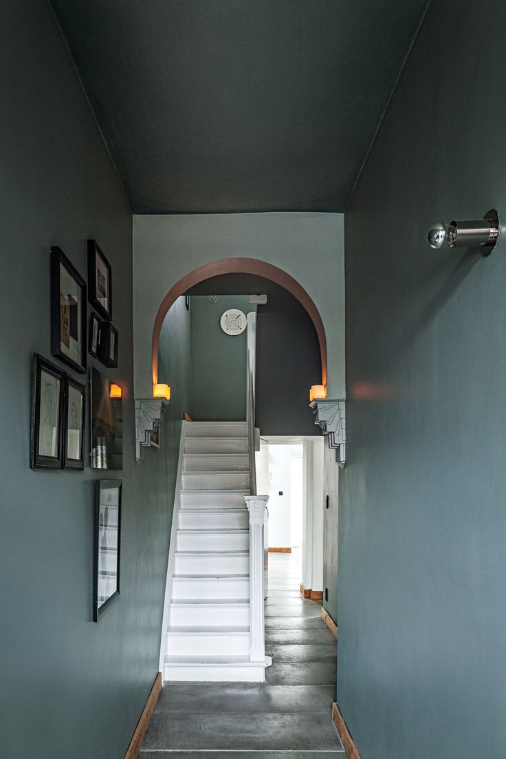 The couple retained the strongest architectural aspects of the house, such as the existing arch in the hall, and did away with others, such as a previous kitchen renovation.