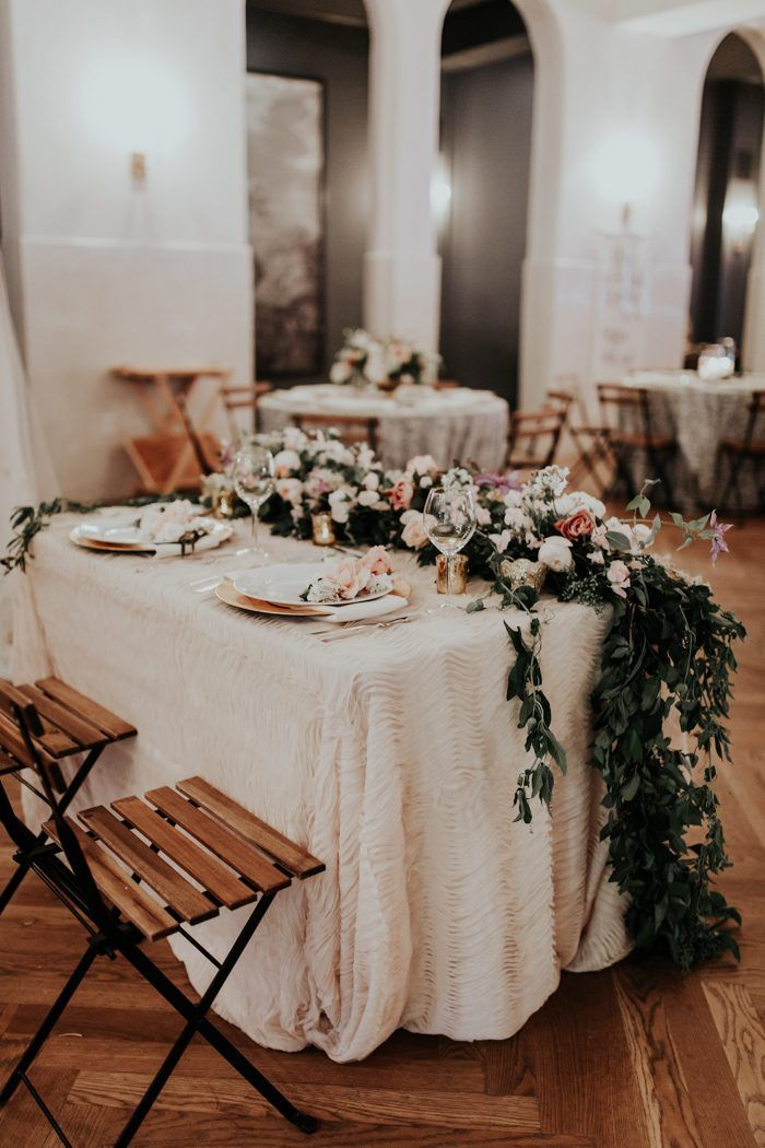 This Il Mercato wedding felt like an upscale indoor garden party complete with lush florals, impressive table garlands, glitzy details, and dessert buffet.