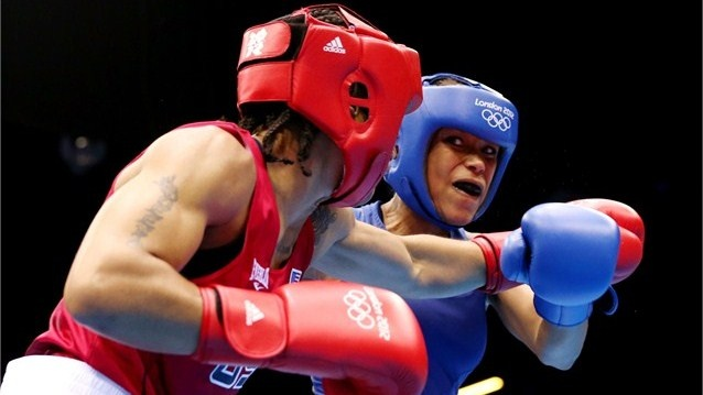 Natasha Jonas of Great Britain (R) in action with Quanitta Underwood of United States during the women's Light (57-60kg) Boxing on Day 9