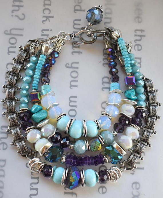 ❘❘❙❙❚❚ ON SALE ❚❚❙❙❘❘   - This new southwestern bracelet is full of vibrant energy and beautiful southwest elements across the board! ~this piece features 4 strands, one of faceted purple crystal, to stacked turquoise, to stacks of faceted opaline, with wrapped Mobius beads, and a center of three expensive stunning robins egg blue turquoise, framed by Mobius beads, and a strand of stacked faceted turquoise, to cubes of AB treated Crystal, to stacked turquoise, silver beads, Mystic ab treated…