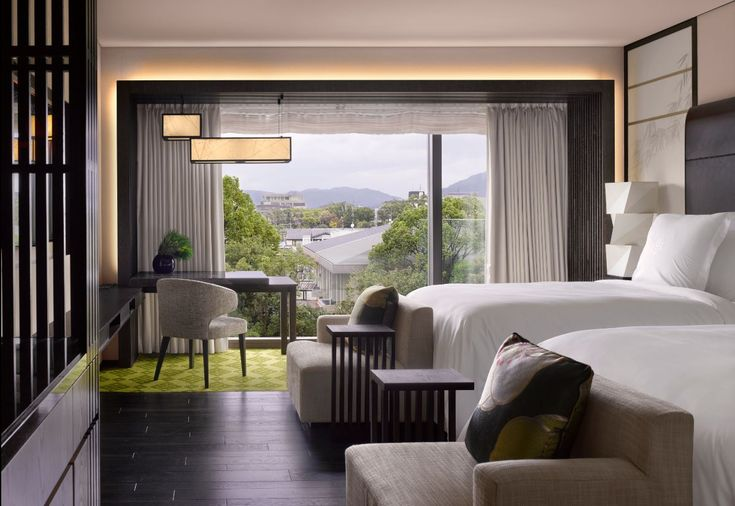 Guestroom with a city view at the Four Seasons Kyoto by HBA Design.