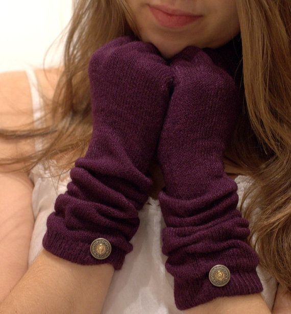 Plum knit long gloves adorned with a button on the bottom. Warm winter gloves for women
