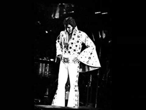 """Peace in the Valley"" by Elvis Presley.  ""Well I'm tired and so weary/but I must go along/till the Lord comes and calls, calls me away/oh yes."""