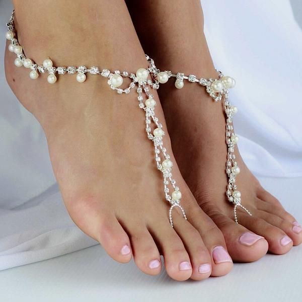 Beautiful Foot Jewelry with Pearls and Rhinestones for the Bride or Bridesmaids. Beaded Wedding Barefoot Sandals with Pearl Detail and an Adjustable Silver Ankle Chain with Toe Ring. Sold as a Pair Shop Barefoot Sandals at Body Kandy Couture. Beautiful Bridal Foot Jewelry for Beach Weddings, Boho Bohemian Weddings for the Bride and Bridesmaids.
