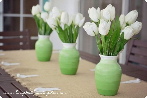 Get crafty with two colors of paint and some vases. | 31 Cheap And Brilliant Dollar Store Hacks