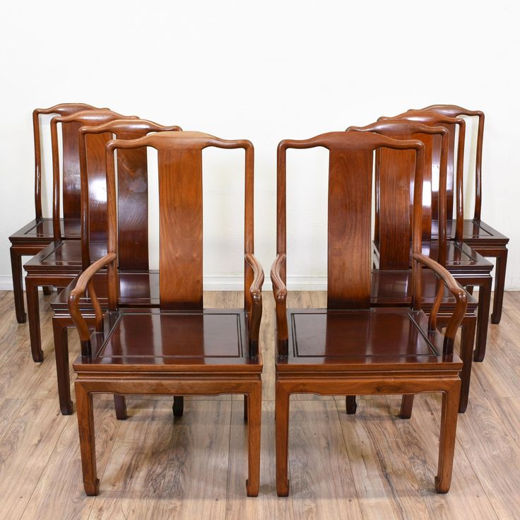These Asian dining chairs are featured in a solid wood with a glossy finish. Each side chair has a carved apron, square design on its seat, and curved arms. An elegant addition to the dining room! #asian #chairs #diningchair #sandiegovintage #vintagefurniture