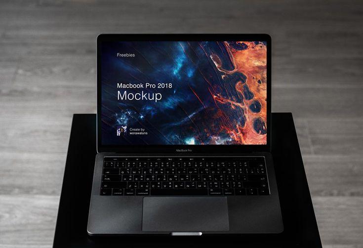 MacBook Pro on a dark Table Mockup
