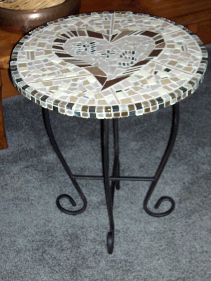 Mosiac table- love the initials in the middle. Nice for the patio.