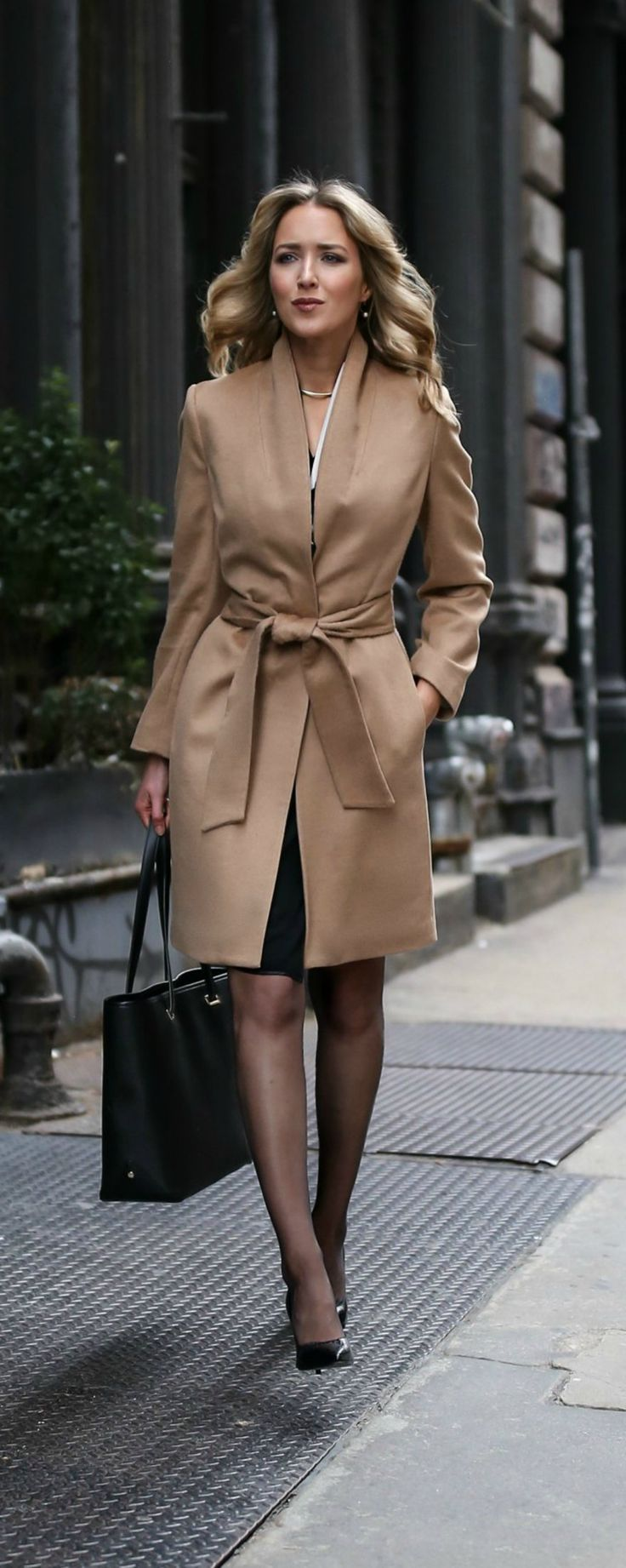 camel tie waist classic wool coat, black faux wrap front v-neck short sleeve sheath dress, sheer black tights, timeless black pointed toe pumps, gold choker necklace, work tote bag | /mmlafleur/