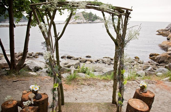 rustic outdoor wood and babys breath altar for wedding at Whytecliff Park