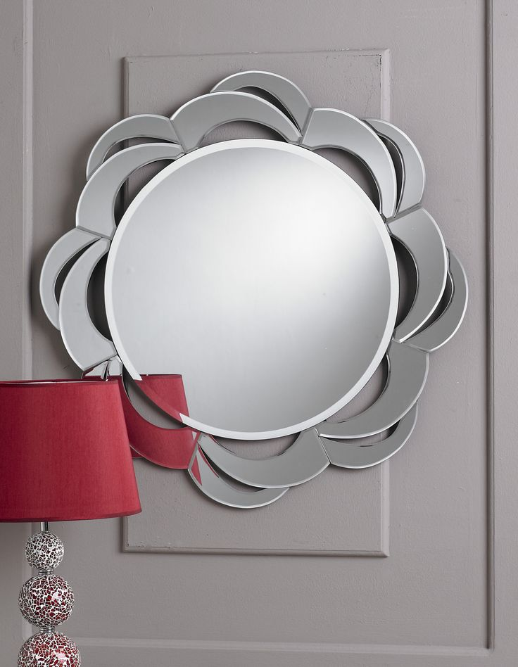 This is a stunning multi facet mirror in the shape of a rose. This mirror is very unique and unusual. It would look very attractive on your wall and is a very neat mirror.