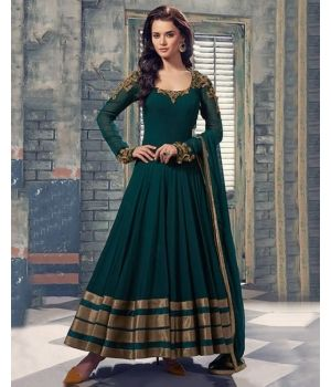 Gorgeous Green Net Designer Suit $82.48.Be a style icon as you flaunt this Gorgeous Green Net Designer Suit from the house of Lurap. Crafted in net, this one comes in the most amazing shade of green, which is complemeted by dull copper colored embroidery on the neckline and sleeves.