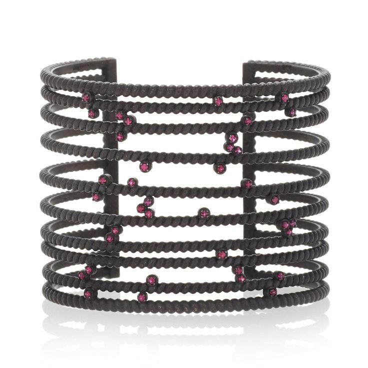 Nancy Newberg sculptural bangle mimicking wrought-iron fences, with Gemfields rubies scattered across the bars. http://www.thejewelleryeditor.com/jewellery/article/gemfields-x-muse-jewelry-collaboration-everyone-is-talking-about/ #jewelry