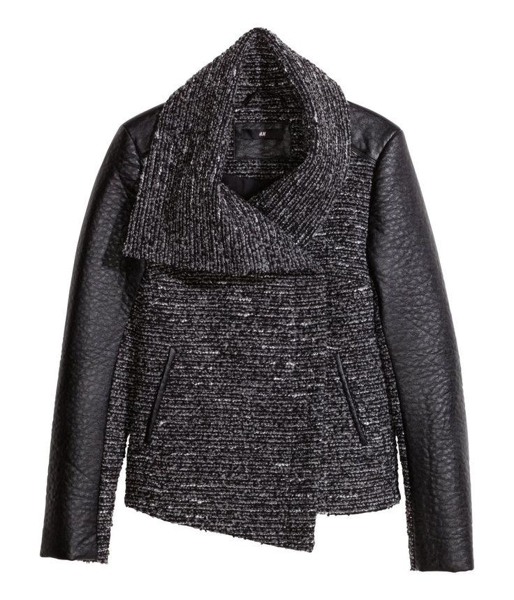Black textured bouclé jacket with imitation leather sleeve panels, asymmetric collar, and diagonal zipper. #WARMINHM