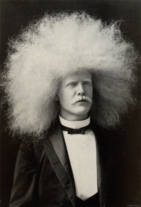 Early 1900's albino white afro. It is what it is!