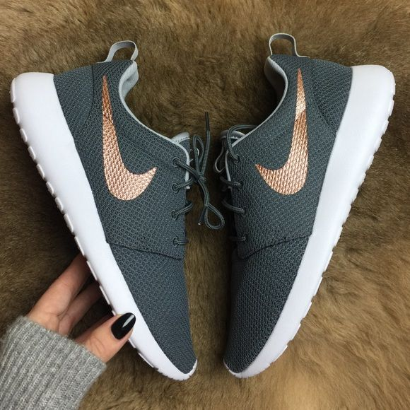 Brand new no box Nike id roshe custom grey wolf color with rose gold swoosh! No trades!price is firm!SUPERIOR VENTILATION AND CUSHIONING Ultra-lightweight and breathable, the Nike Roshe One Women's Shoe features a full mesh upper and EVA foam outsole. The