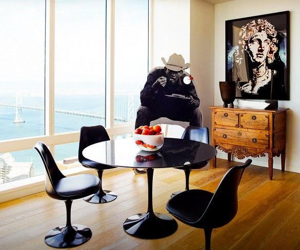 Black Tulip Dining Set In Dining Room With Floor To Ceiling Windows