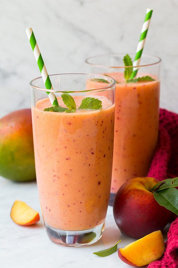 How dreamy wouldit be to enjoy this seriouslyrefreshing, ice cold, fruit packedMango Peach and Strawberry Smoothie while your soaking up the sun on a be