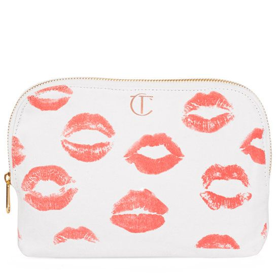 <p>The Charlotte Tilbury Makeup Bag is a cotton canvas makeup bag  printed with the fabulous lip prints of some of the most iconic women in fashion. It's the perfect size for holding all your makeup when you're on the go! The bag has a gold zip, black lining and is machine washable. </p>