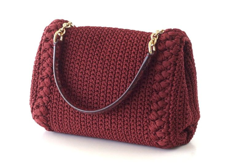 Guaranteed authentic DOLCE&GABBANA Purse Crochet hand / shoulder bag. Jewel toned Burgundy crochet bag with rich texture. Handle is gold chain and red snake