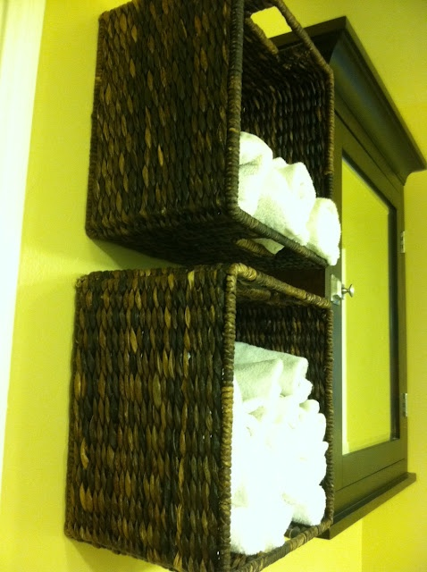 fantastic idea for towel storage in a bathroom! wall mounted baskets--love!   Need this so bad!