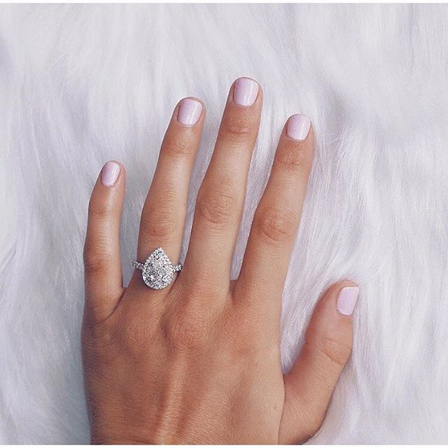 theknot: Double-tap if you @vkmitch's amazing pear-shaped diamond engagement ring as much as we do! #theknot #theknotrings