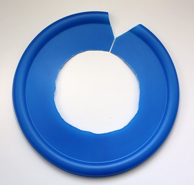 Inexpensive splash guard for mixer.  However, instead of a lid, I would use one of the heavier duty bendable plastic dishes you use for picnics, etc..  Also invert it so the raised portion is on top thus allowing more room.