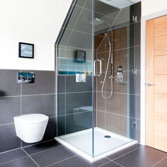 This clever, compact cubicle makes the most of an awkward attic area. The glass enclosure is unobtrusive, and the floor and wall tiles blend beautifully to enhance the sense of space here.