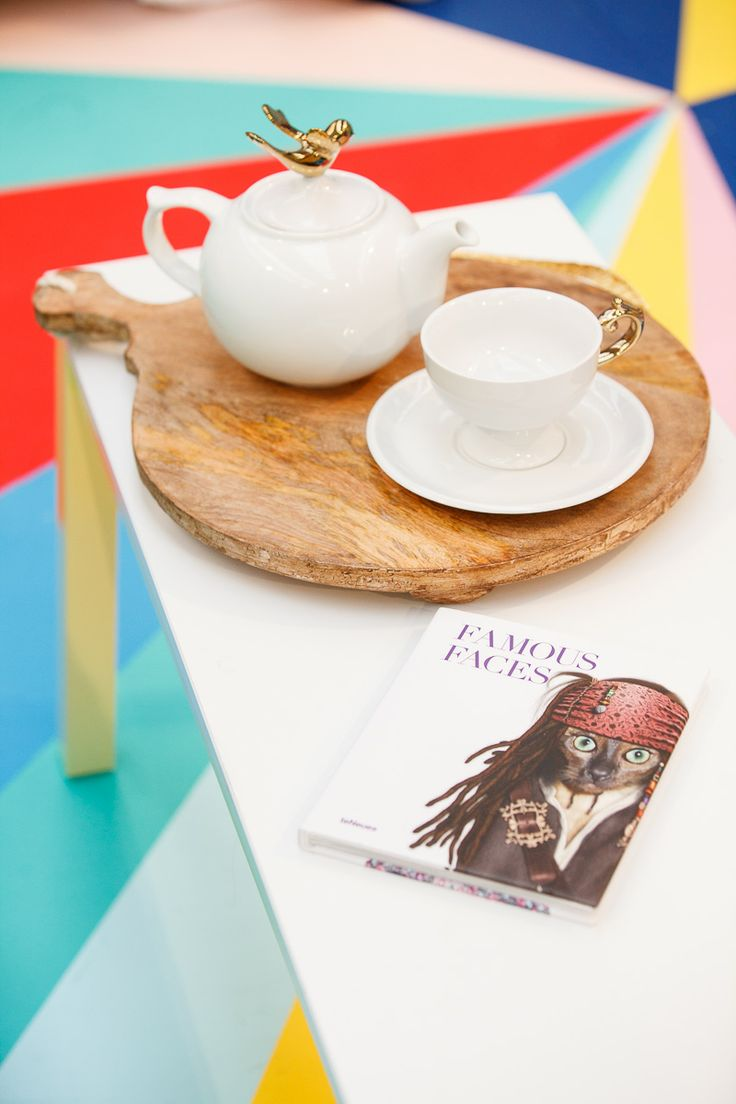 In The Colour Studio. Wooden chopping block from Wheel and Barrow, tea set and book from Urban Attitude