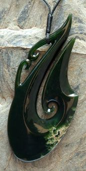 Pounamu (new Zealand Jade) Matau/Manaia necklace by master carver Peter Bishop. The Matau or hook is a symbol of a strong willed leader and also gives protection when traveling over water.