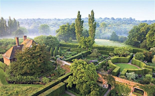 The South Cottage and the rondel in the Rose Garden seen from the Tower at Sissinghurst Castle Garden, near Cranbrook, Kent