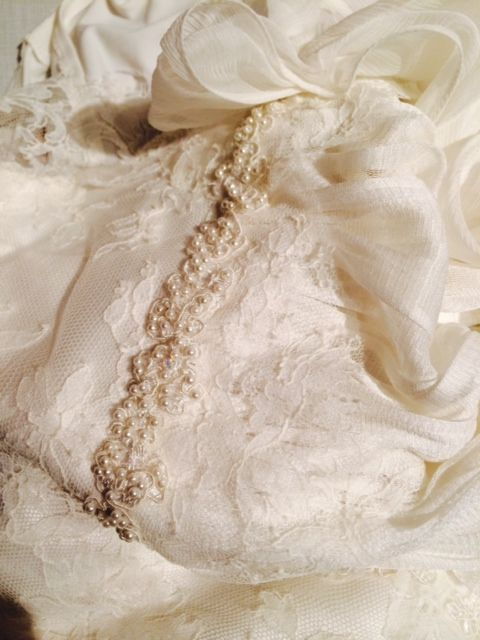 Gorgeous, fine lace and pearly beads.