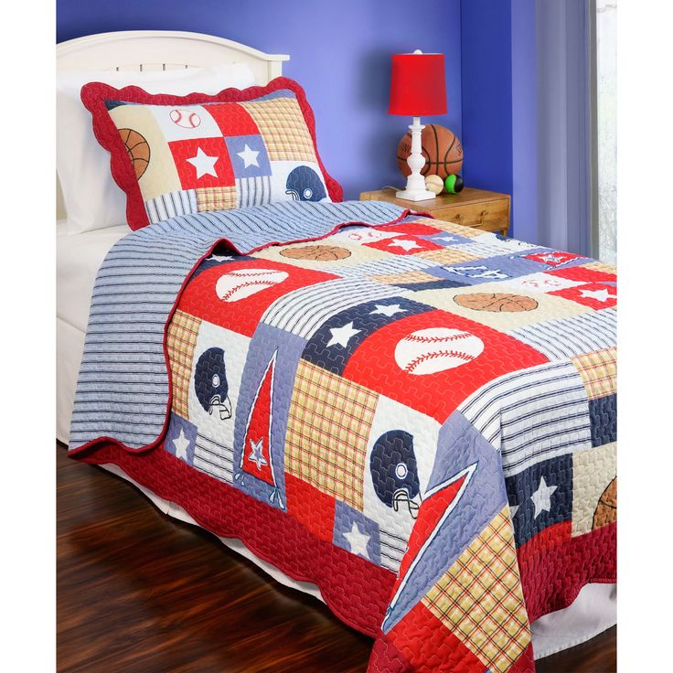 The perfect all-American addition to your child's bedroom, this sport themed quilt is reversible to a complementary pattern. This quilt is finished with vermicelli embroidery and scalloped edges for added style and durability.