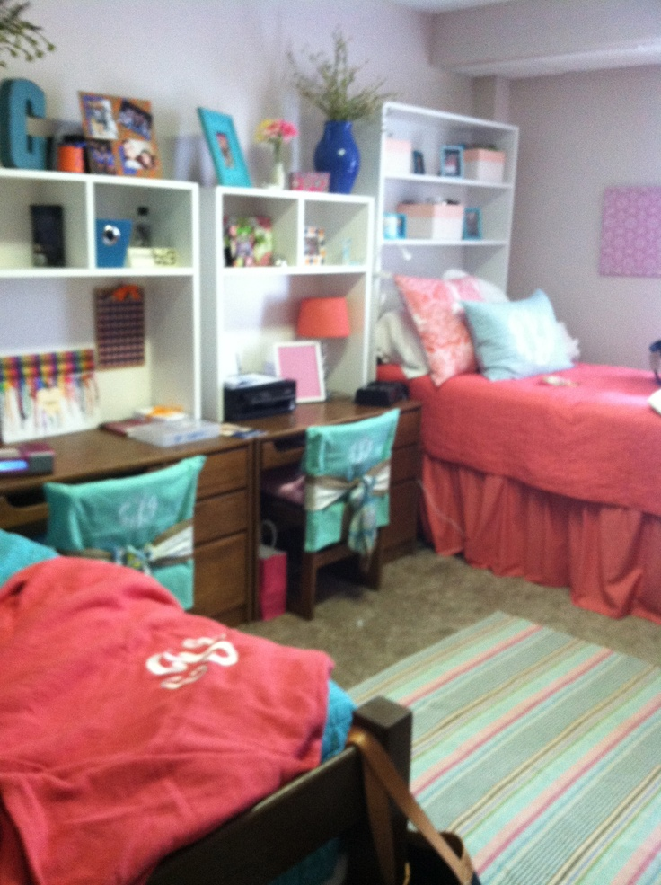 Cool Dorm Design - Like the matching coral bedspreads! @Cassidy Nicole this looks like our color scheme (except theirs is coral)