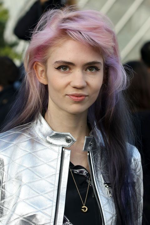 Working her signature woodland elf meets super cool musician look, we're loving Grimes' pastel pink and black hair.