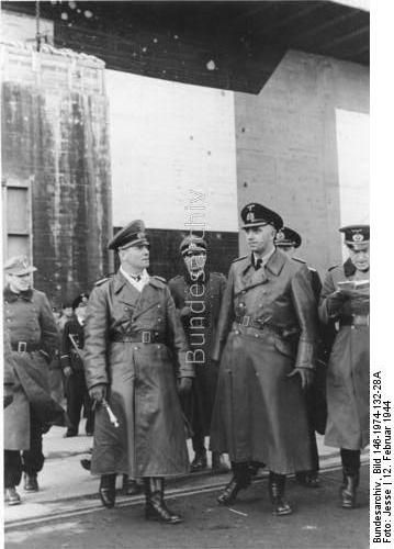 La Rochelle, France, 2/12/44, Field Marshal Rommel in the Bay of Biscay. Field Marshal Rommel before one of the huge bomb-proof bunkers, of a U-Boat submarine pen. H.KBZ.b.HGr.D., Film No. 198/32, picture Reported by: Jesse. Many of these  photos stills from the many propaganda films.
