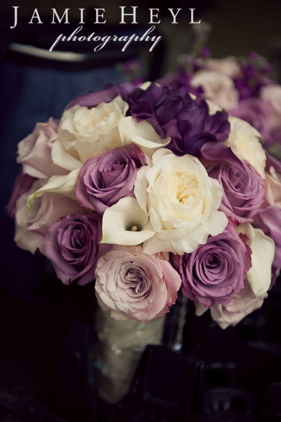 Wedding bouquet purple and white roses