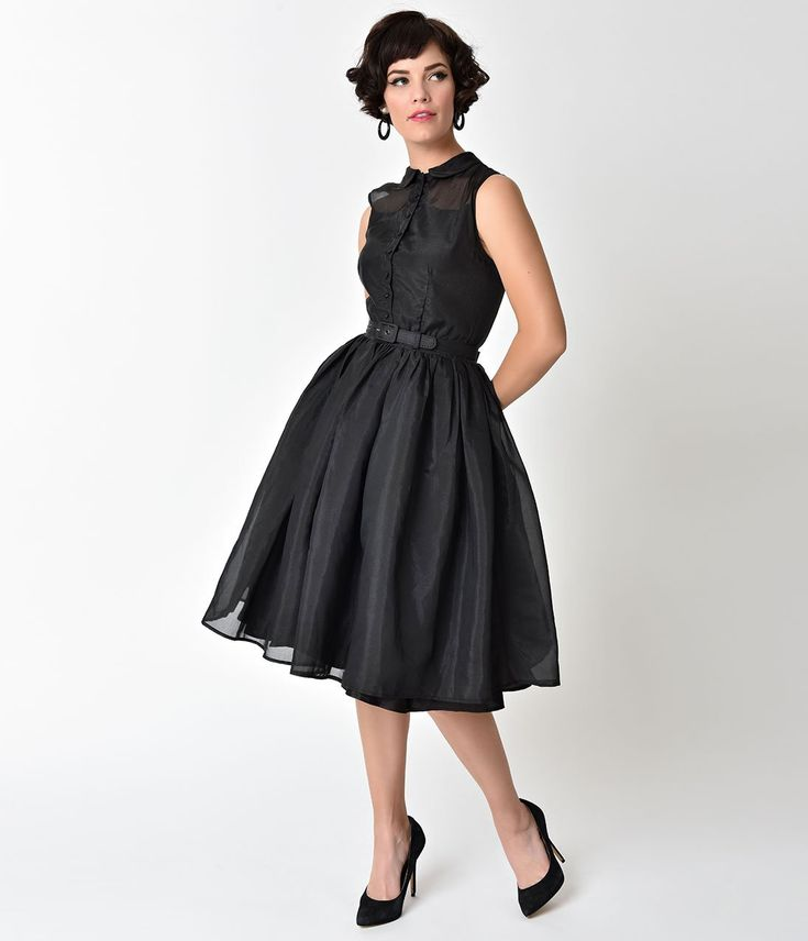 Raise your standards, dolls! A romance infused stunner from Unique Vintage, the Georgia Swing Dress is an elegant 1950s inspired frock for a vintage peach! Covered in an enchanting gauzy layer of shimmering black poly organza resting over shiny black lining for a marvelous peek-a-boo effect. A sleeveless button up bodice boasts darted seaming that ends at the natural waist, where a fluid skirt billows past knee length and a black adjustable belt nips in your feminine figure. Continue with…