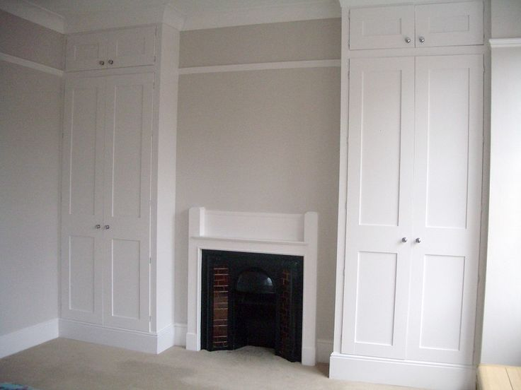 Built-in tall wardrobes
