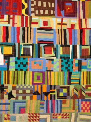 "Lisa Filion's Quilt at Waterwheel House Quilt Shop.  Improv piecing, big stitch hand quilting ""a la Kaffe Fassett"""