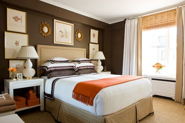 Cream, Brown and White with orange to give a pleasing warm feel and a spacious enviroment....dark feature wall option could be swapped with the colour of the bed for a more airy look.