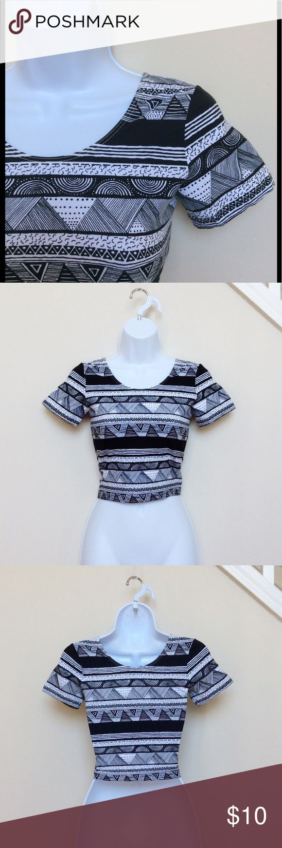 American Apparel Black and White Aztec Crop Top Black and white short sleeve crop top with Aztec pattern from American Apparel.  This top is brand new, but it was bought online, so it does not have store tags. Size small, measures 15 inches from shoulder. *Please note: There is a rip in the seam near the shoulder, as pictured.  Easily repaired! :) American Apparel Tops Crop Tops