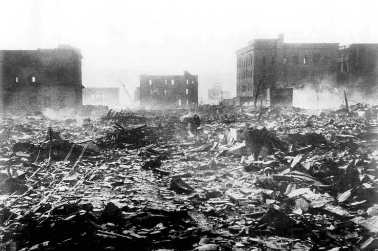 A pall of smoke lingers over this scene of destruction in Hiroshima, Japan, on August 7, 1945, a day after the explosion of the atomic bomb. Nearly 80,000 people are believed to have been killed immediately, with possibly another 60,000 survivors dying of injuries and radiation exposure by 1950.