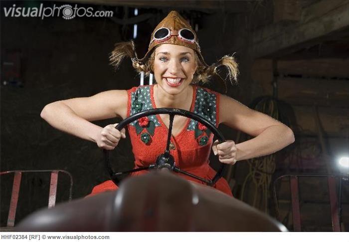 Austria, Salzburger Land, Young woman on tractor, portrait