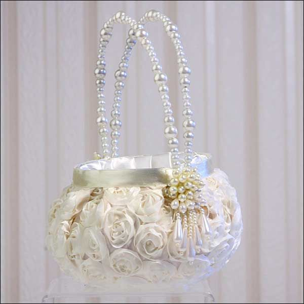 If you need a flower girl basket... this one is gorgeous... it will tie into your theme seemlesly Flower Girl Basket - Floral Garden