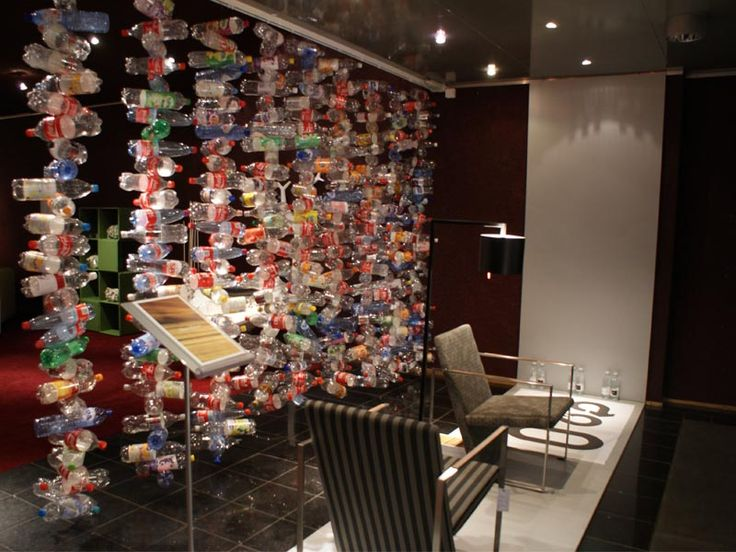 plastic bottle wall, pinned by Ton van der Veer