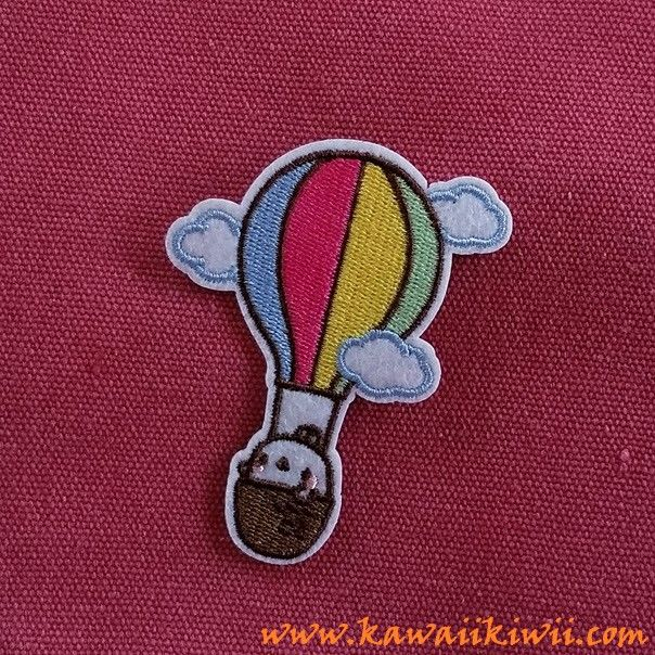 Cute Flying Bunny iron on patch.  Super adorable bunny flying off in a colourful hot air balloon flying through cute little clouds. Go bunny go!!  Iron on patches, badges, pins from anime, sci-fi, fantasy, TV series, movies and more. From www.kawaiikiwii.com